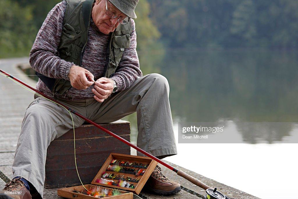 Senior man preparing the bait for fishing