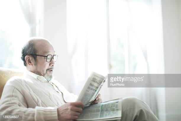 Senior man reading a newspaper