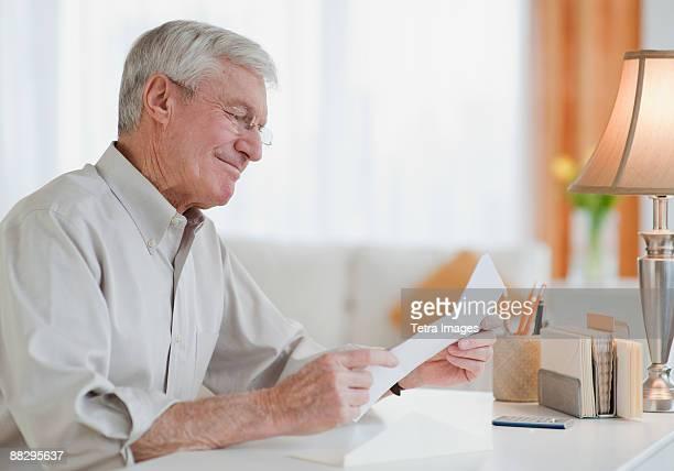 Senior man reading letter