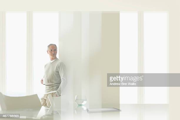 Senior man relaxing in a city apartment