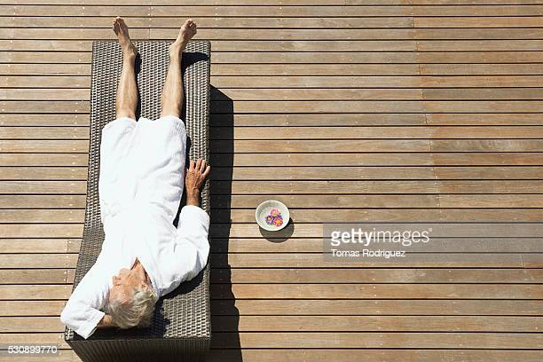 Senior man relaxing in deck chair