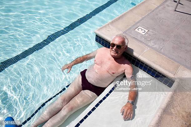 Senior man relaxing in pool.