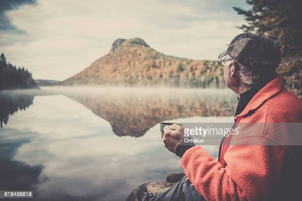 Senior Man Relaxing with Coffee in Nature