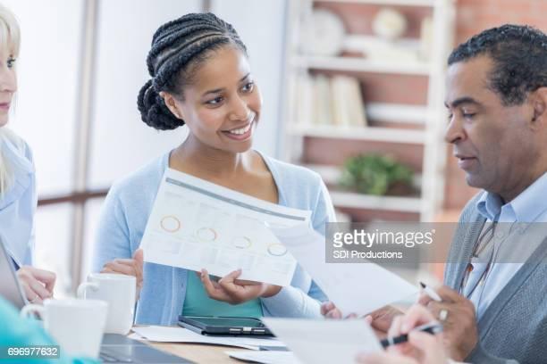 Senior man reviews financial document
