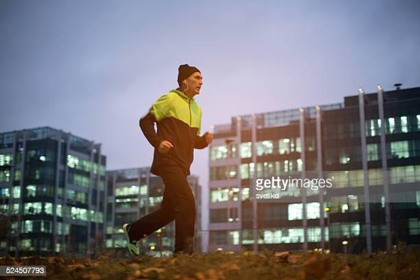 Senior man running at night.