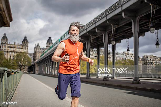Senior man running in the city