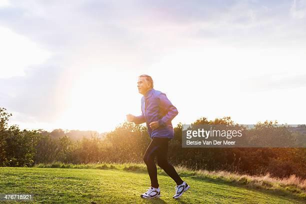 Senior man running outdoors.