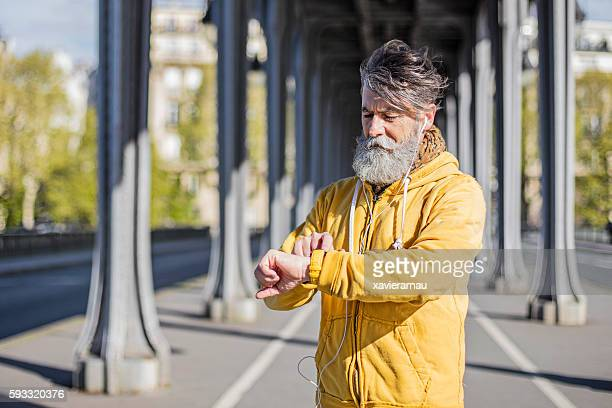Senior man setting up the smart watch