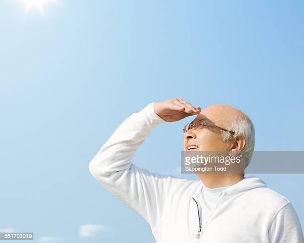 Senior Man Shielding Eyes