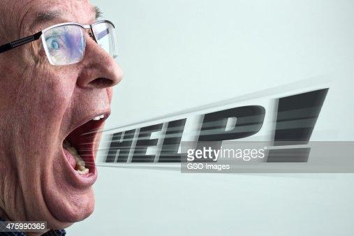 Senior man shouting for help : Stock Photo