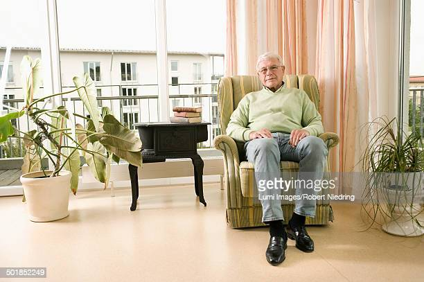 Senior man sits in nursing home, Bavaria, Germany
