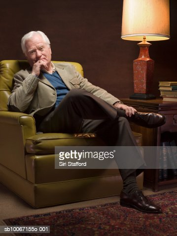 Old man sitting stock photos and pictures getty images for Sitting in armchair