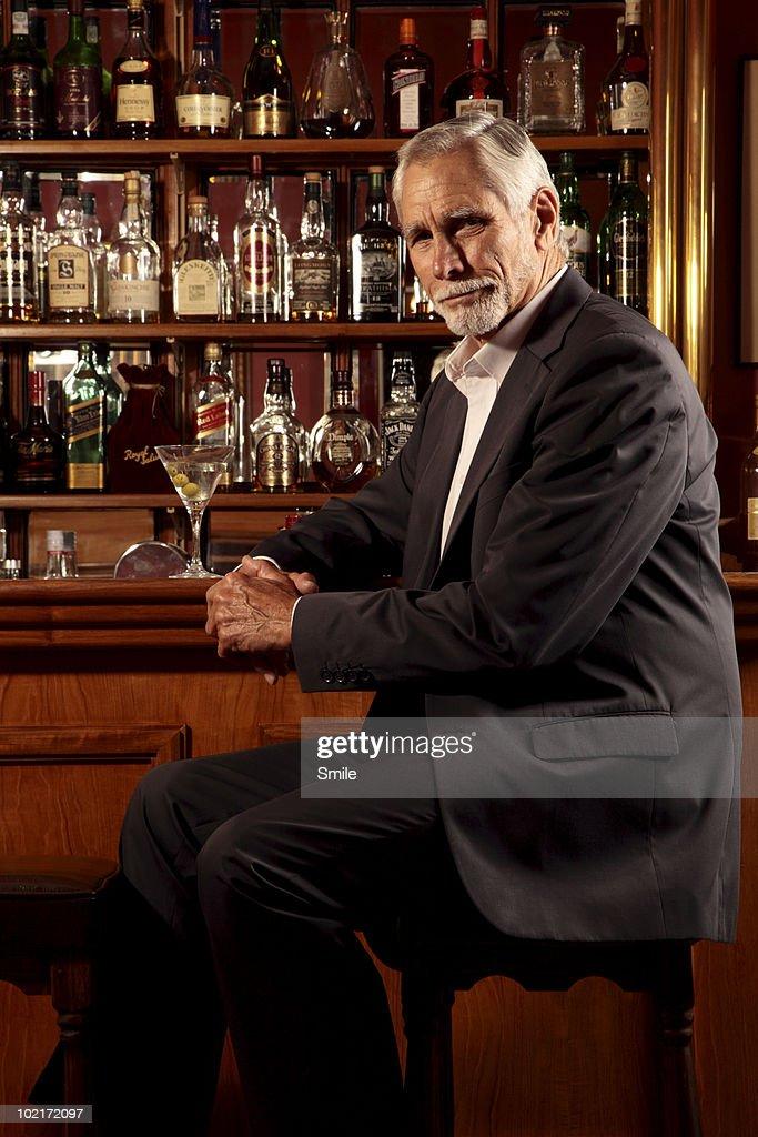 Senior man sitting in the bar : Stock Photo