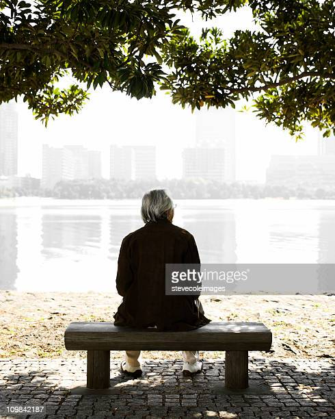Senior Man Sitting on a Park Bench