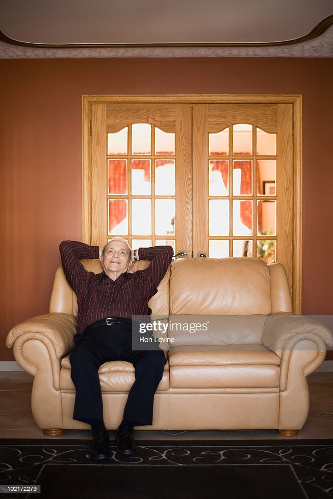 Senior man sitting on a sofa, relaxing
