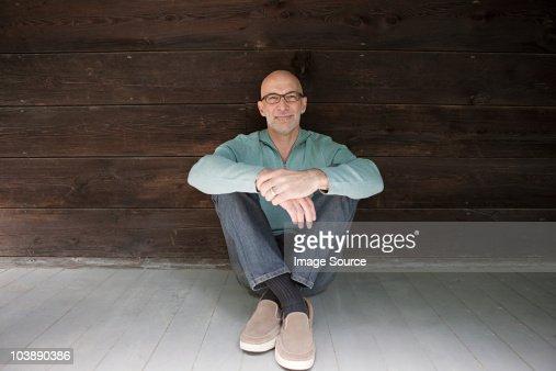 Senior man sitting on floor : Stock Photo