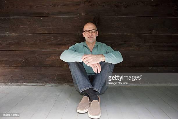 Senior man sitting on floor