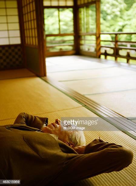 Senior Man Sleeping On Tatami Mat