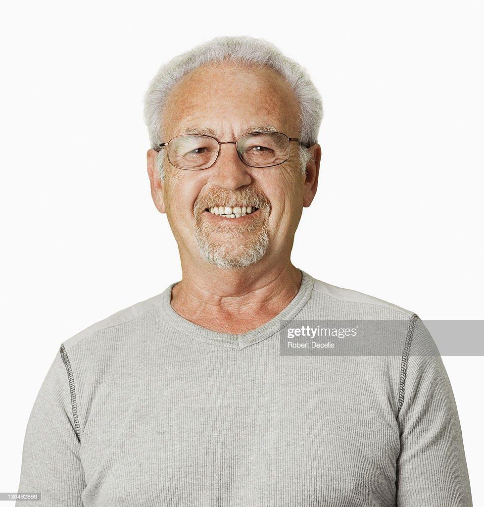 Senior man smiling at camera : Stock Photo