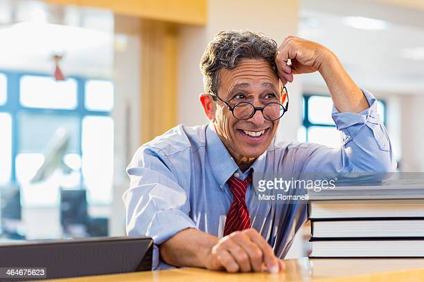 Senior man smiling in library