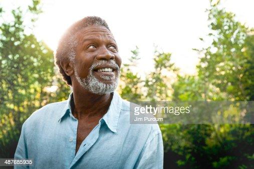 Senior man smiling outdoors