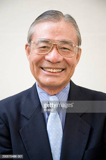 Senior man smiling, portrait, close-up