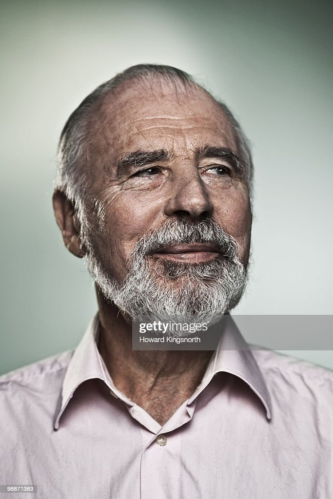 Senior man smiling, portrait : Stock Photo