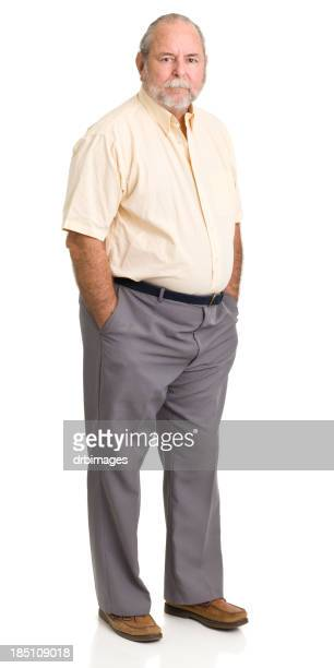 Senior Man Standing With Hands In Pockets