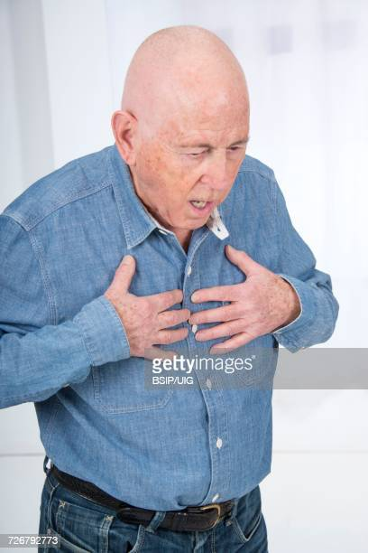Senior man suffering from chest pain