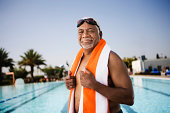 Senior man swimmer with towel