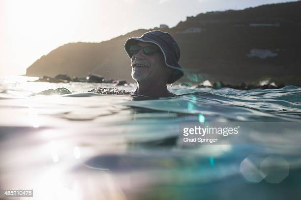 Senior man swimming in the sea