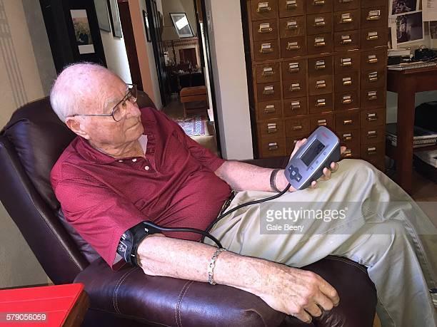 Senior man taking Blood pressure at home