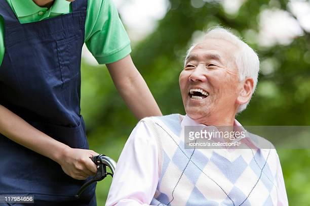 Senior Man Talking with Social Worker