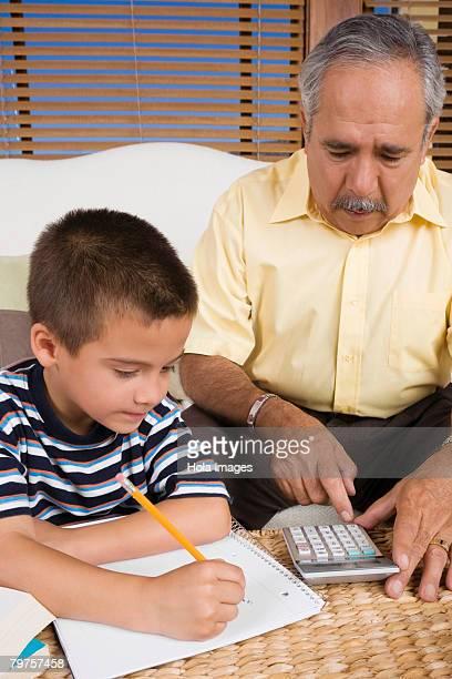 Senior man teaching his grandson