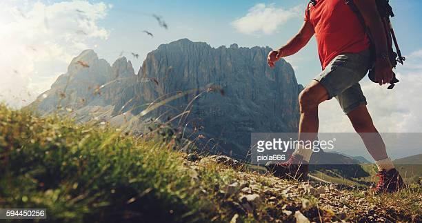 Senior man trail hiking on high mountain