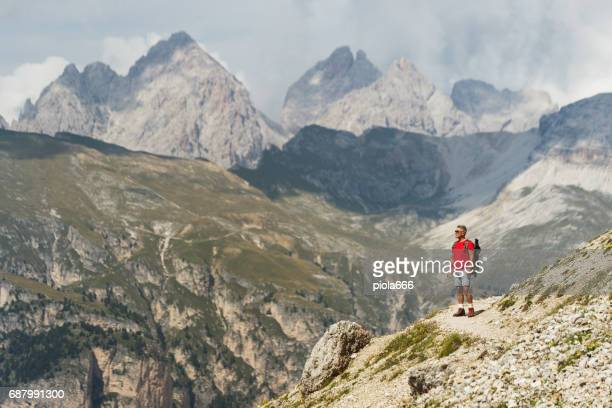 Senior man trail hiking on the Alps