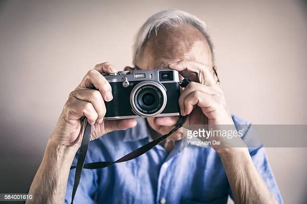 Senior Man Using a Camera
