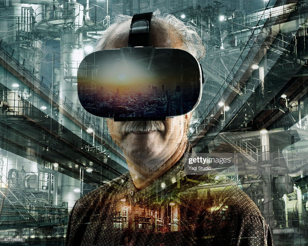 Senior man using a virtual reality headset. : Stock Photo