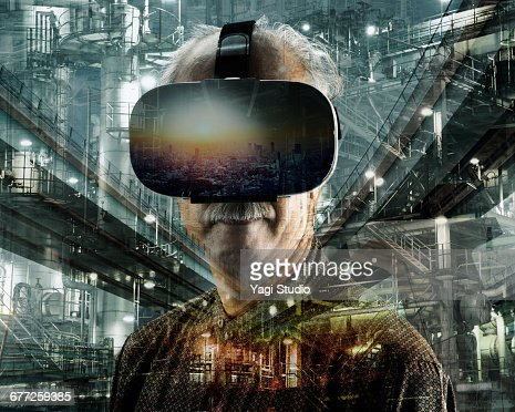 Senior man using a virtual reality headset. : Stock Photo