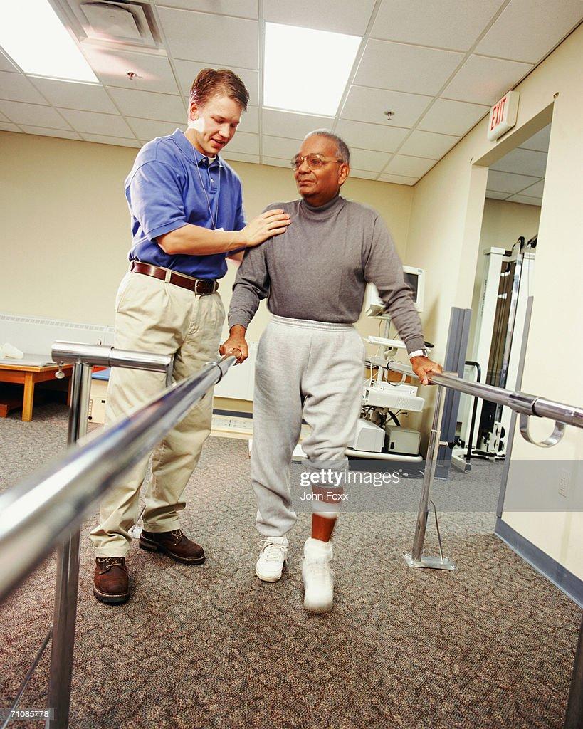 Senior man using bars to walk