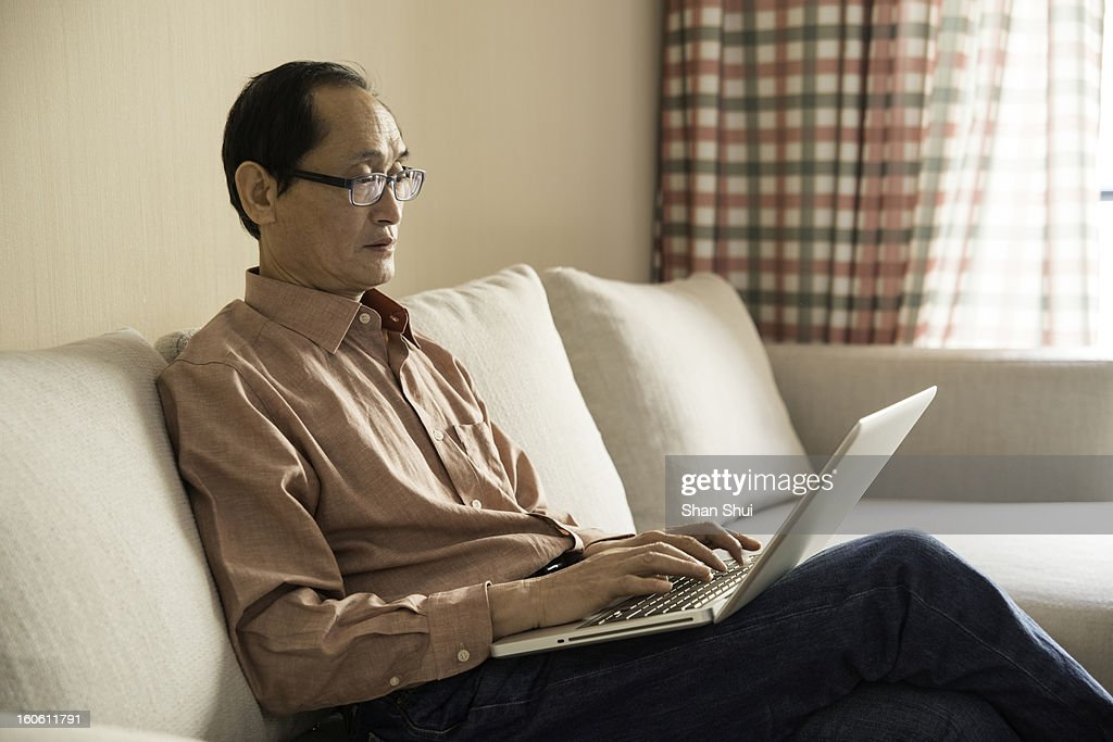 senior man using laptop : Stock Photo