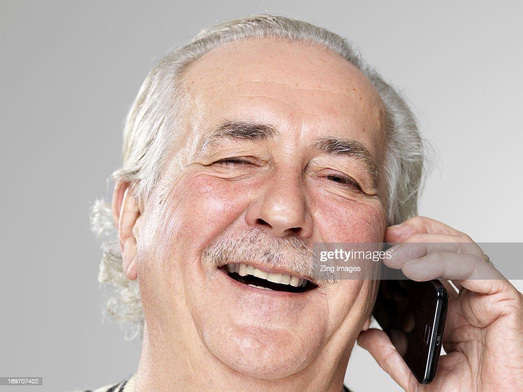 Senior man using smart phone : Stock Photo