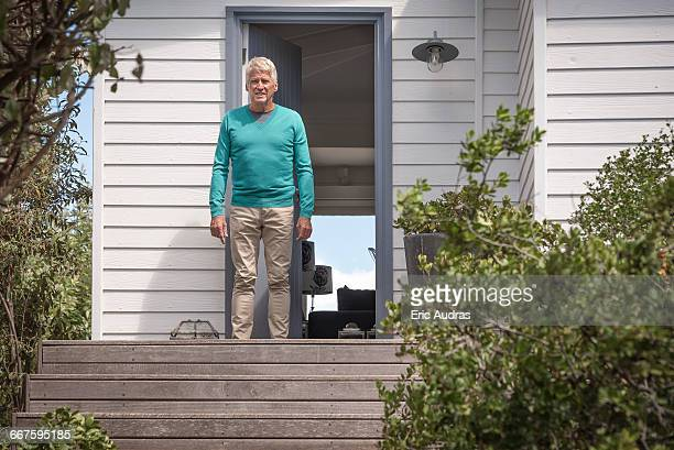 Senior man waiting at doorway