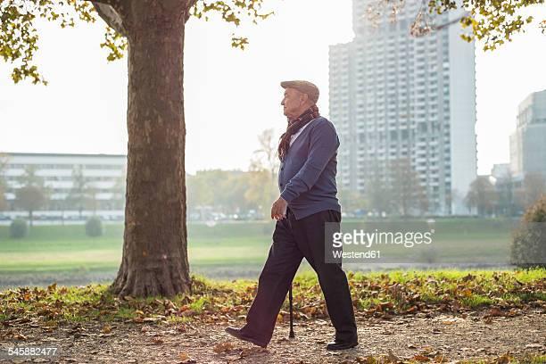 Senior man walking by the riverside
