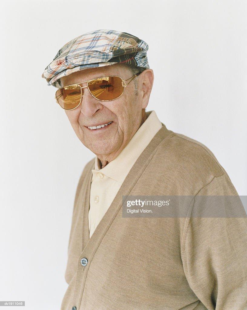 Senior Man Wearing a Flat Cap and Sunglasses