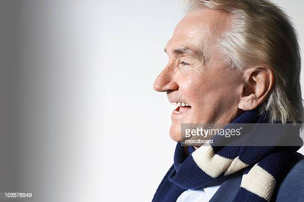 Senior Man Wearing a Scarf, head and shoulders, in studio