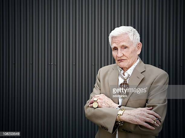 Senior Man Wearing Gold Jewelry