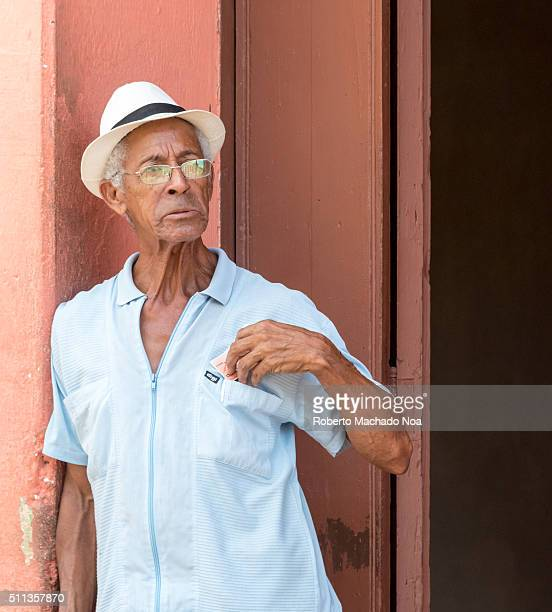 Senior man wearing hat standing outside his house in Cuba Cuba has two million people who are 60 and over and by 2030 that number will be around 33...