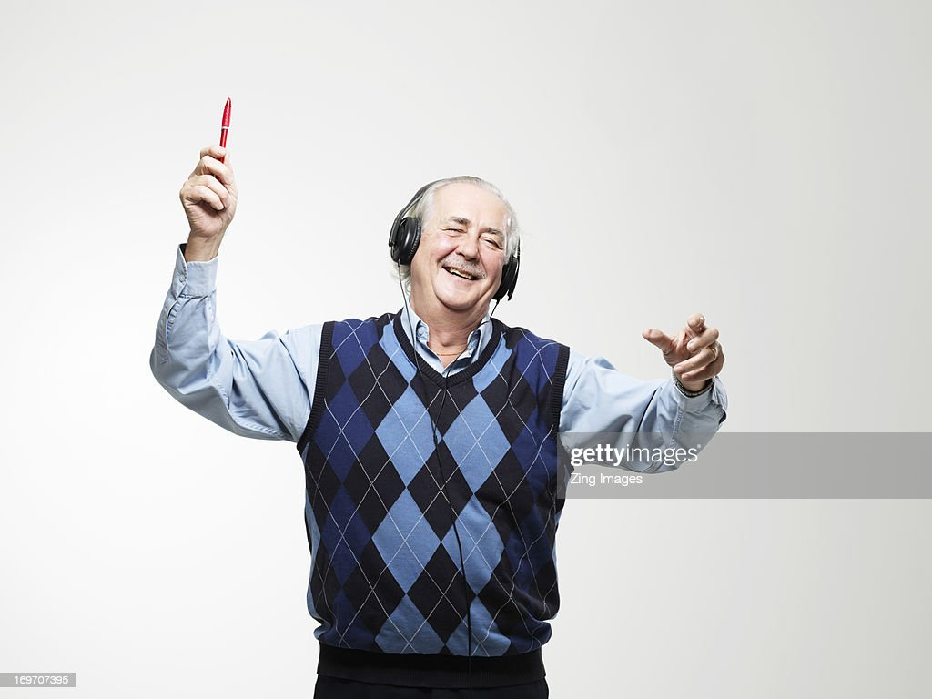 Senior man wearing headphones : Stock Photo