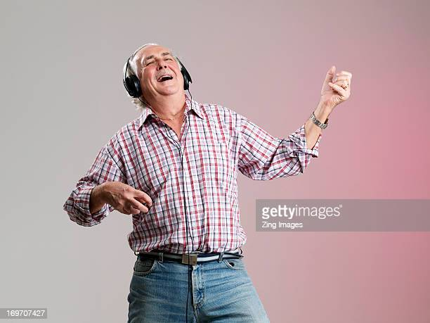 Senior man wearing headphones